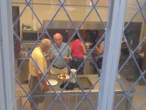 Church volunteers Bob Glidden, Frank Settle and Libby Cumming prepare breakfast